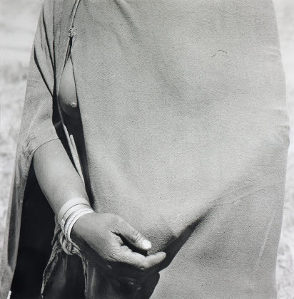 Woman going to the trading store holding money under her blanket, near FlagstaffFrom the 'Particulars' series, 1975 - 2007